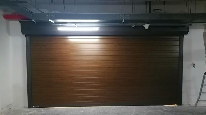 铜辉门窗|中粮瑞府车库门安装